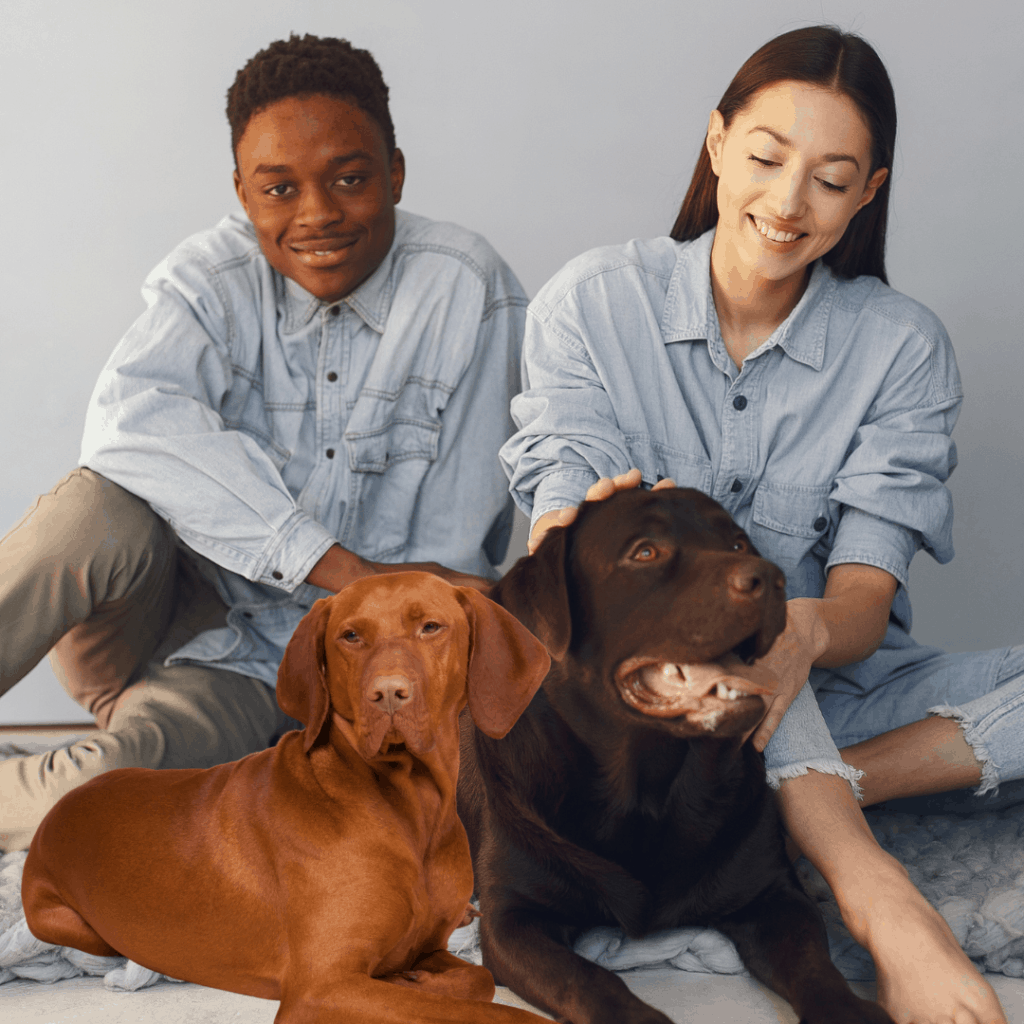 2 people of color with their dogs