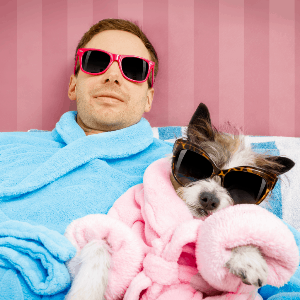 Clean man and dog wearing sunglasses and robes
